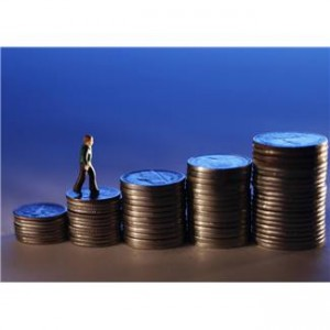 A Picture of a Toy Many Climbing a Stack of Coins