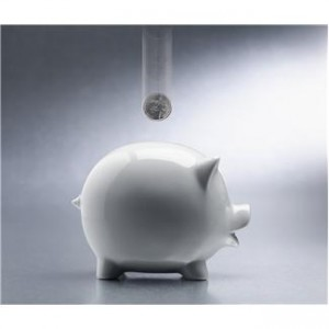 An Image of a Coin Dropping Into a White Piggy Bank